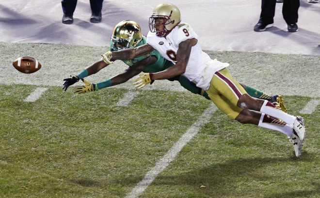 Boston College defensive back John Johnson (9) breaks up a pass to Notre Dame wide receiver Chris Brown, left, during the third quarter of the 2015 Shamrock Series NCAA college football game at Fenway Park on Saturday. (Charles Krupa/AP)