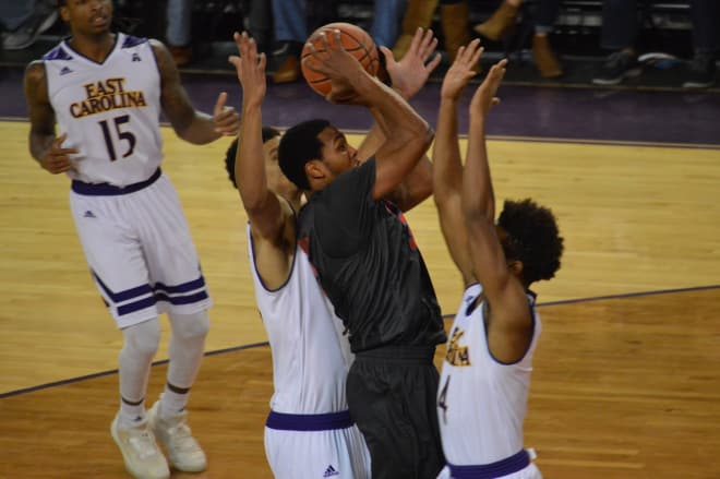 SMU's Sterling Brown shoots over ECU's Elijah Hughes and Andre Washington in a 75-44 win.