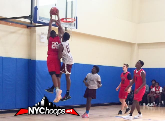 Zed Key (#26) takes it up and over his defender at the rim
