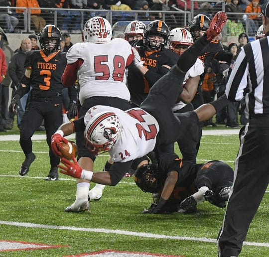 Cameron Porter scores one of his three TDs in the Lancers' state title game victory.