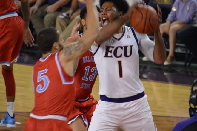 Jayden Gardner works in the paint against Delaware State's Tyler Foster in ECU's 81-56 opening night win.