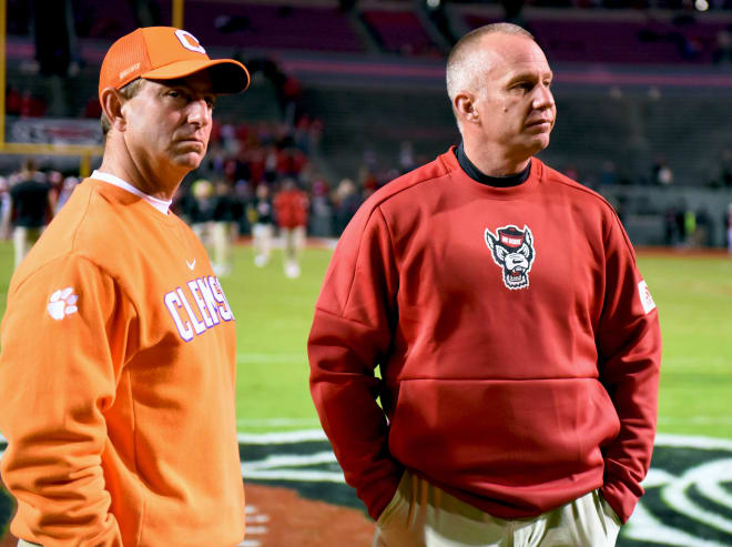 Head coach Dabo Swinney (left) and the Tigers clinched the ACC Atlantic Division title with their 55-10 victory over head coach Dave Doeren (right) and the Wolfpack on Saturday.