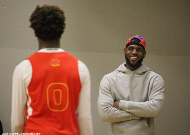 LeBron James watches his son Bronny