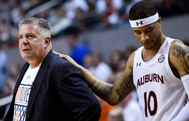 Samir Doughty (10) stands with Bruce Pearl during Auburn vs. Kentucky.
