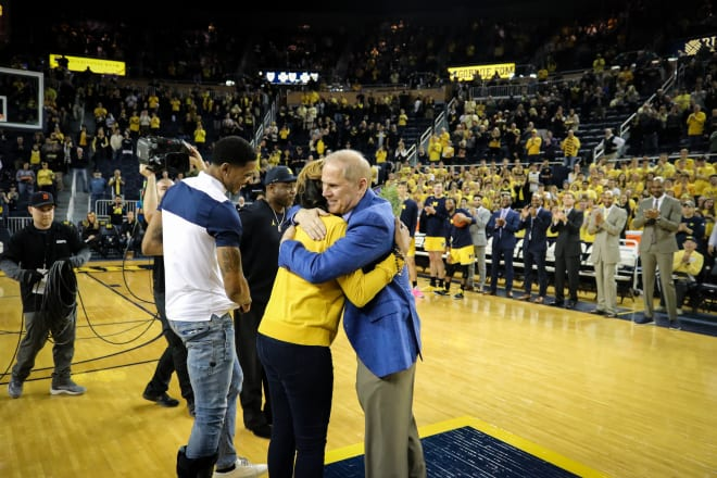 John Beilein hugs Charles Matthews' mom.