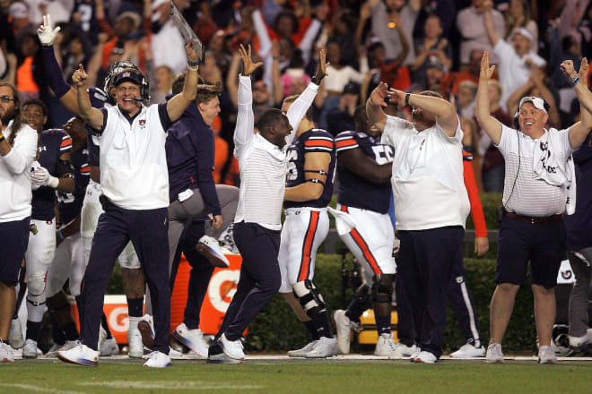 Malzahn and Auburn's sideline celebrate a big fourth-quarter play.