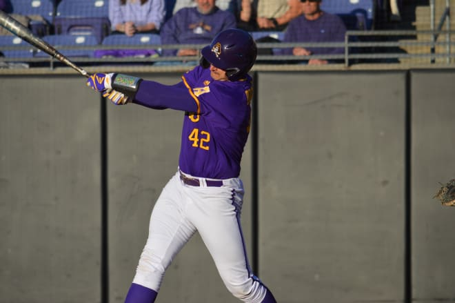Spencer Brickhouse pounds a three-run homer in the eighth inning to help secure a 7-4 series win over UCF.