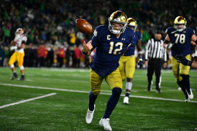 Notre Dame quarterback Ian Book celebrating after a touchdown that gave the Irish a 10-point lead against Rival USC(Andris Visockis)