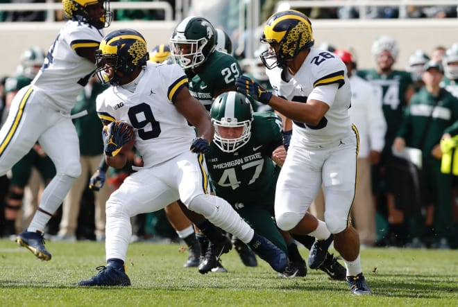 After lengthy lightning delay, MI tops MSU 21-7