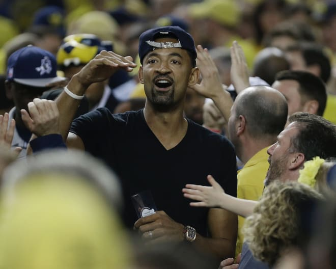 Watch Juwan Howard break down in tears at MI press conference