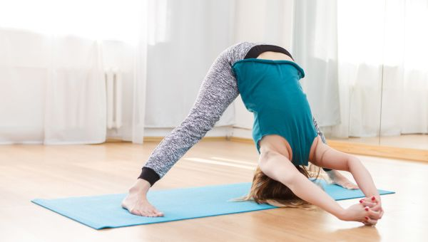 Wide-Legged Standing Forward Bend with Arm Variation