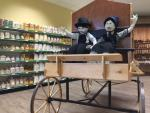 Store display with dolls and buggy at Black Buggy Bulk Foods shop