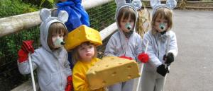 children at Seneca Park Zoo's Zoo Boo event dressed as mice and cheese