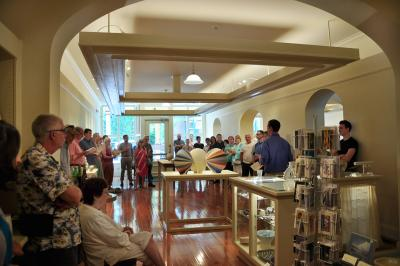 People standing around the Main Street Arts gallery