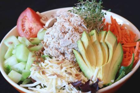 Tito's Avo Classic Salad from Avocado Cafe features tomatoes, tuna, cheese, and a wide variety of vegetables (Photo courtesy of Avocado Cafe)