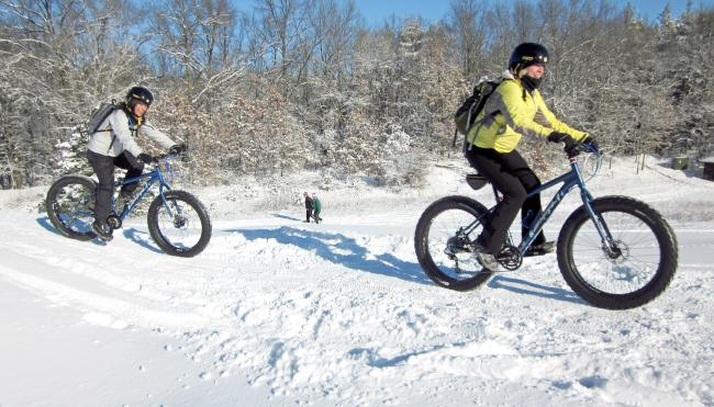 People Winter Cycling at Winter Adventure Race