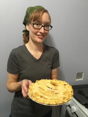 Grape pie contest winner Meghanne Freivald holds a grape pie