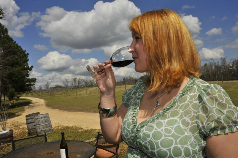 Sampling wine at Pontchartrain Vineyards