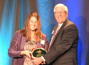 Shannon Manning, Ph. D. accepting the Community Champions award for James Tiedje, Ph. D.