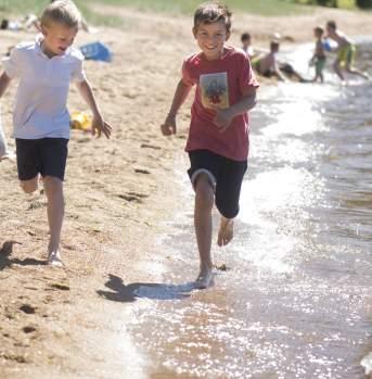 Children on Kvavik beach Lyngdal Norway