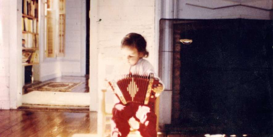 Sarah Savoy Playing Accordion as a Child