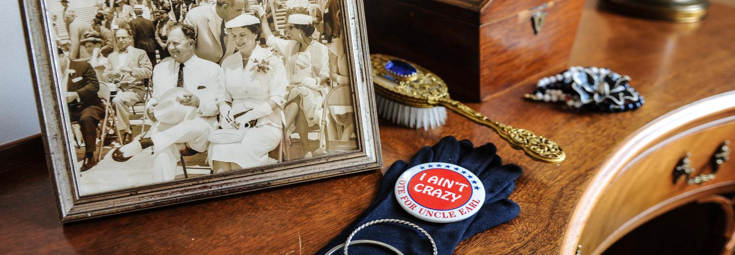 Display of historic photo and items on desk in the Old Governor's Mansion