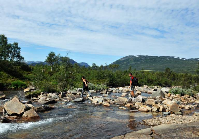 Crossing river in the mountains of Hovden