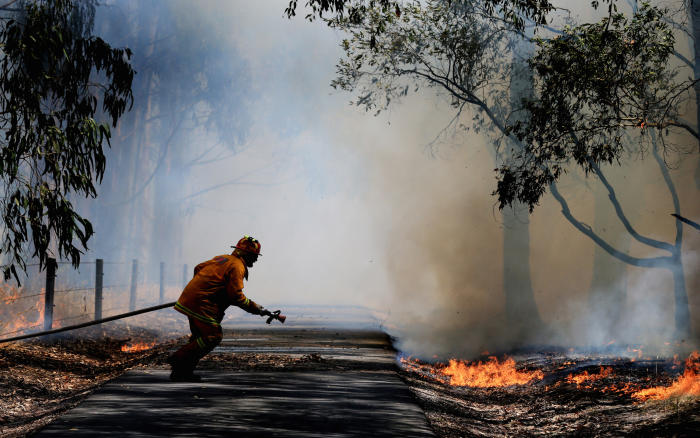 A CFA firefighter attacks a blaze started by lightning at Trafalgar, Victoria, in 2014. Picture: Alex Coppel/Herald Sun