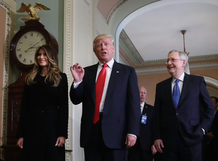 Donald Trump, his wife, Melania, and Senate Majority Leader Mitch McConnell after a meeting on Capitol Hill on November 10, 2016. Picture: Mark Wilson/Getty Images