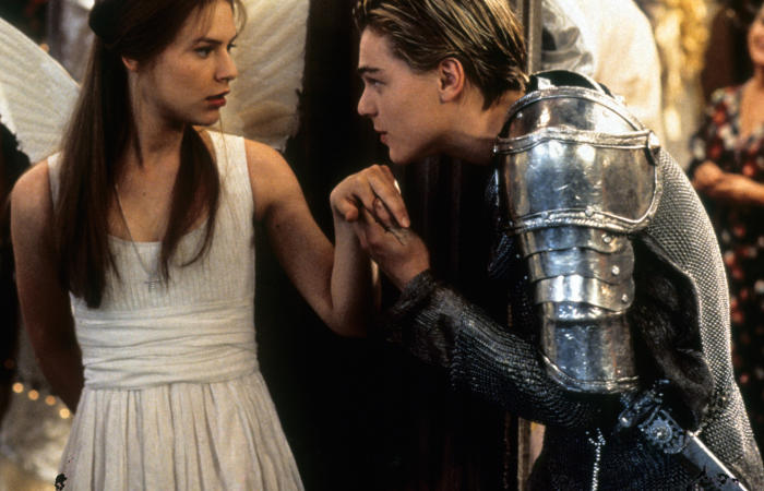 Claire Danes is surprised as Leonardo DiCaprio takes her hand to kiss in the 1996 film Romeo + Juliet. Picture: 20th Century Fox/Getty Images