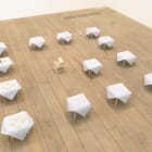 Sam Anderson, Table 2, 2013, napkins, wood, wax, sand, teeth, peanuts, flowers, and pharmaceuticals