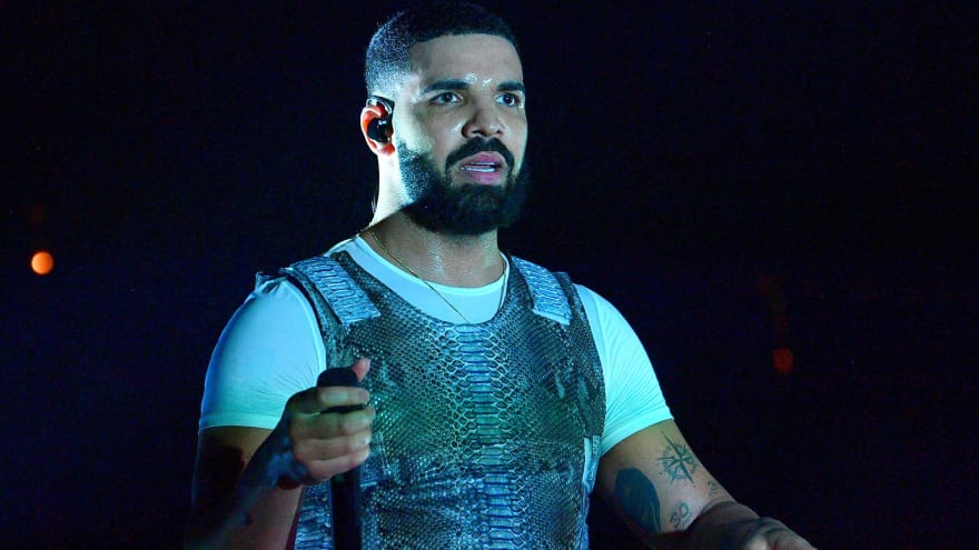 Drake wears perfect NFL sweater to address alleged 'Drake Curse'