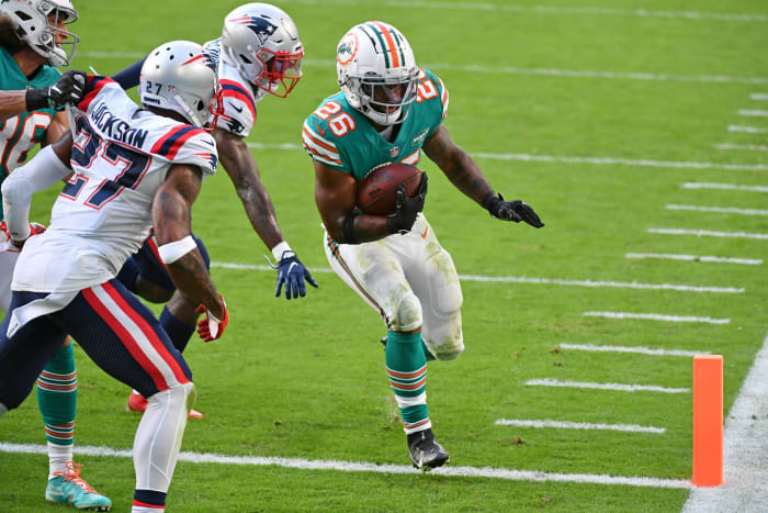 Dolphins backfield keeps playoff journey on course