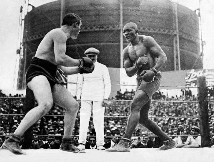 1908: First Black Heavyweight Boxing Champion: Jack Johnson